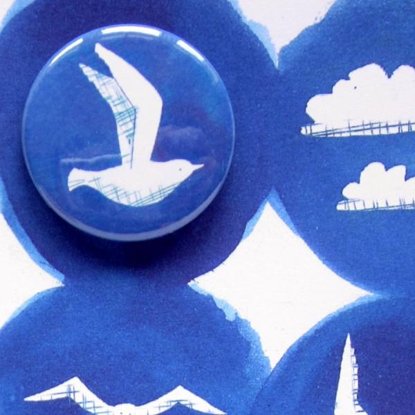 seaside seagulls and sun badge card