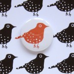 greetings card with red bird and badge