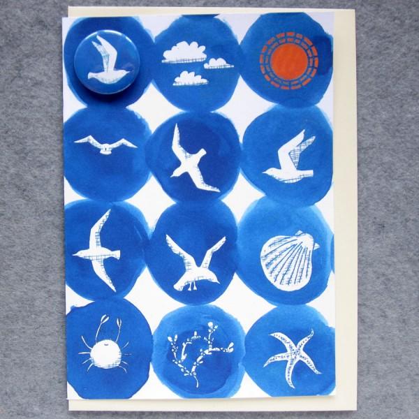 seaside greetings card with badge
