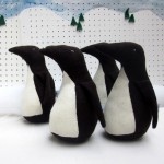 handmade knitted penguin toy animal and book