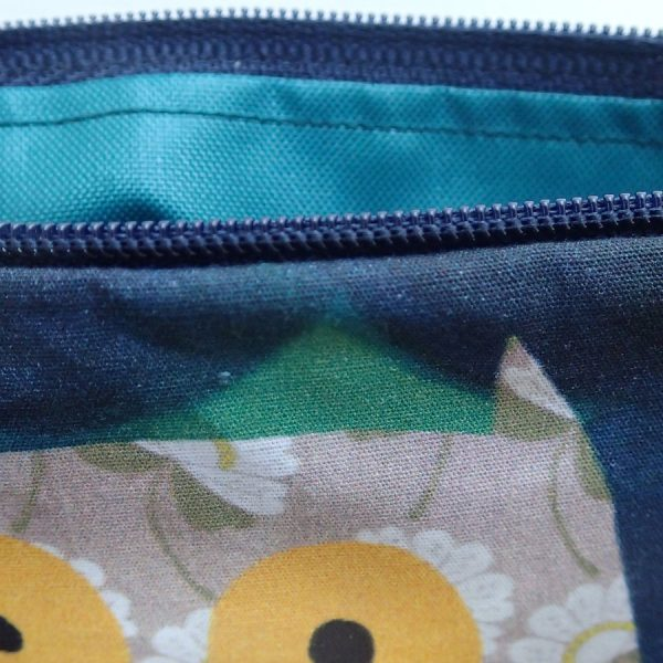 zip wash bag illustrated with owl by the black rabbit