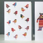christmas badge greetings card robin by the black rabbit