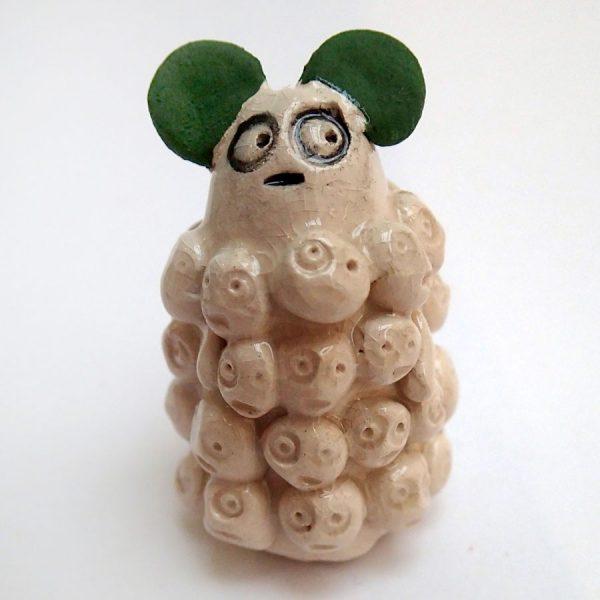 ceramic creature by the black rabbit