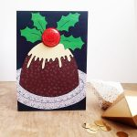christmas pudding badge greetings card by the black rabbit