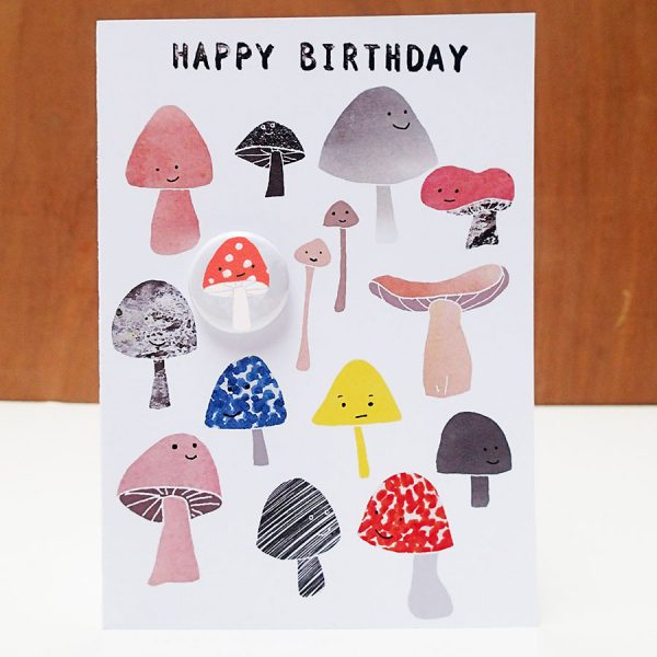 Mushroom birthday greetings card with badge by the black rabbit