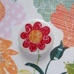 the black rabbit flowers badge  greetings card