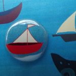 sunny boats badge greetings card by the black rabbit
